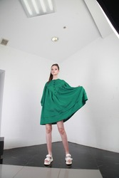 Oversize concept. Short dress fashion trend. girl posing in fashionable green dress. Clothes accessory for summer. Young fashion model wear dress for spring and summer season. Shopping. copy space