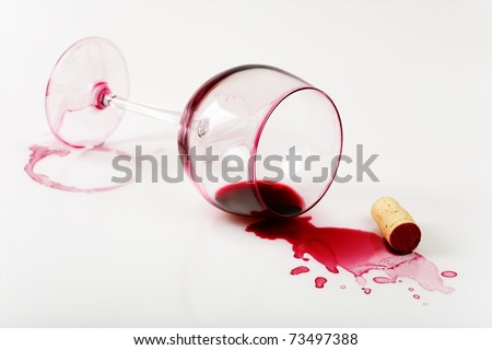 Overturned glass , poured wine and stains