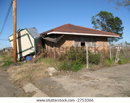 overturned shed still sits against one of the casualty homes in the lower ninth ward of New Orleans, 18 months post-Katrina - stock photo