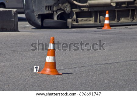 Overturned transport on accident site with traffic cones #696691747