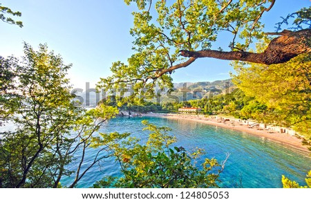 Overview from scenic beach and green mountains in the beautiful bay, Mediterranean sea (Italy), wide angle