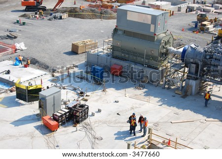 overview of construction workers and site