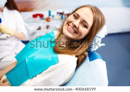 Overview of dental caries prevention.Woman at the dentist\'s chair during a dental procedure. Beautiful Woman smile close up. Healthy Smile. Beautiful Female Smile