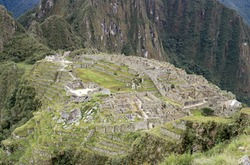 Overview of Machu Picchu inca buldings, and mountains surroudings. Peru