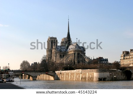 Overview of Notre Dame by the River Scene at sunset in Paris France
