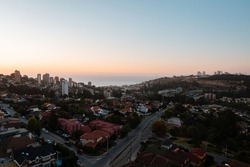 Overview of Reñaca's town near of Viña de Mar, Chile on a beautiful sunset with the beach in the background