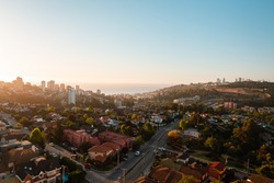 Overview of Reñaca town near of Viña del Mar in Chile on a sunset with waves crashing in the coastline