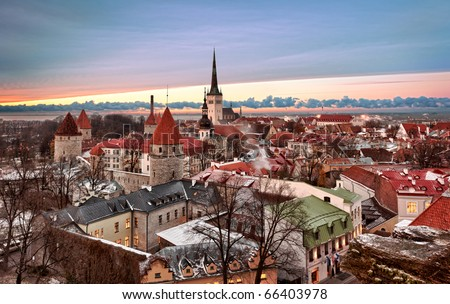 Overview of Tallinn in Estonia taken from the overlook in Toompea showing the town walls and churches. Taken in HDR to enhance the sunset
