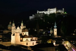 Overview of the old town of Salzburg by night, Austria.