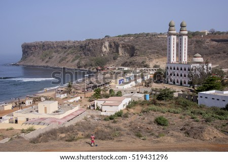 Overview of the small fishing village and its Divinity mosque on the coast of Dakar, Senegal #519431296