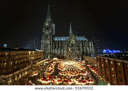 Overview over the Christmasmarket with the Cologne Cathedral. Part of the UNESCO Worldheritage. The most visited object of interest in Germany is 157.38 m tall.