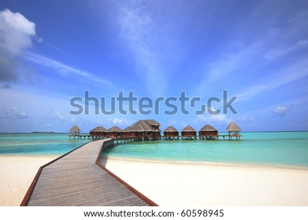 overwater bungalows - stock photo