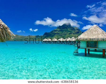 Overwater bungalows of a luxury resort providing a view on the Otemanu, Bora Bora, Tahiti, French Polynesia