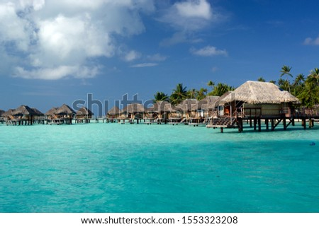 Overwater Bungalows Sitting in Beautiful Turquoise Lagoon Bora Bora #1553323208