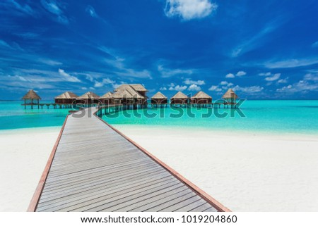 Overwater villas on the tropical lagoon, Maldives islands stock photo