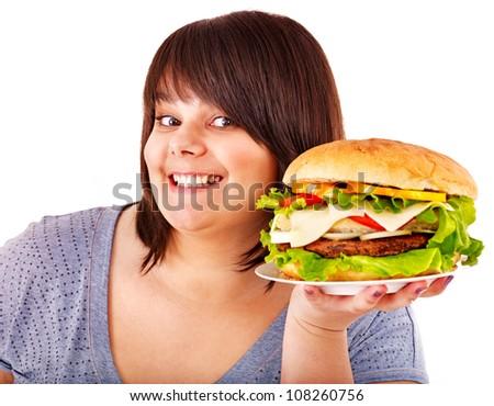 Overweight beautiful woman eating hamburger. Isolated.