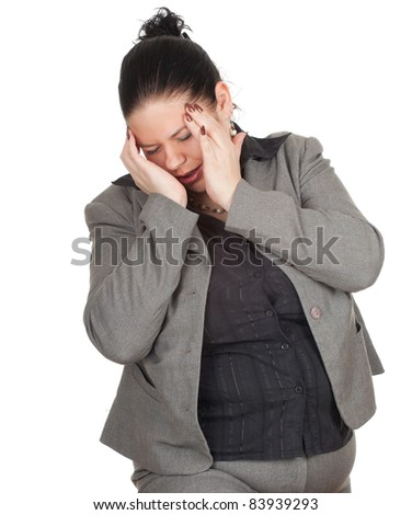 overweight, fat businesswoman in grey suit suffering from pain, headache