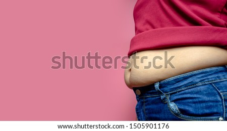 Overweight fat woman isolated on a pink background in Studio, Weight losing, obesity, cellulite, health care concept. copy space background for text