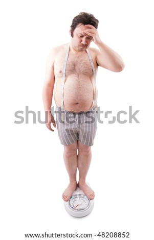 Overweight man on the weight scale