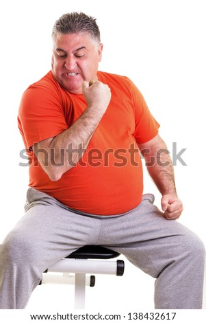 Overweight man showing his strength after doing exercises seated on a bench  isolated on white