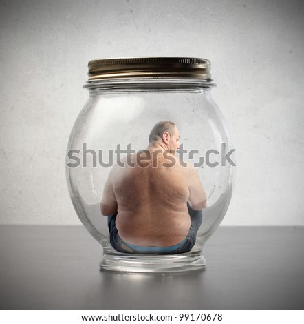 Overweight man sitting in a jar