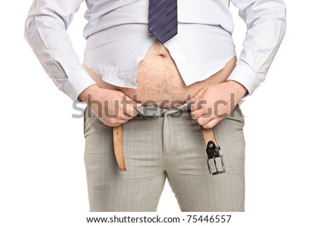 Overweight man trying to fasten too small clothes isolated on white background