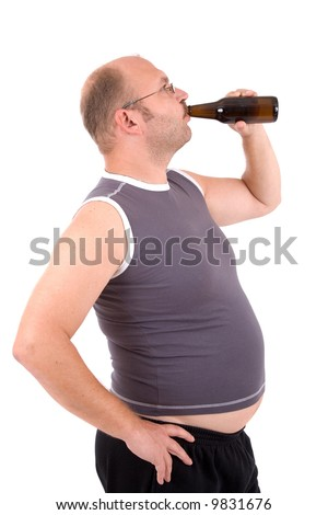 Overweight man with his beer belly sticking out drinking from his beerbottle
