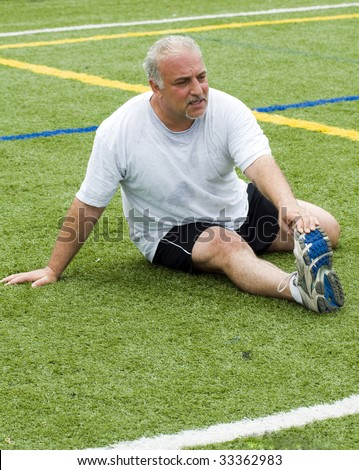 overweight middle age senior man stretching his muscles fitness healthy lifestyle image