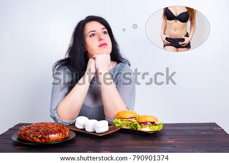 Overweight obese woman with junk food dreaming of fit and slim body. Weight losing, obesity, high-calorie food, unhealthy nutrition,dieting concept