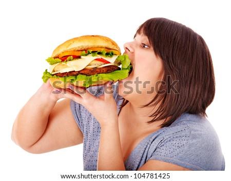Overweight woman eating hamburger. Isolated. - stock photo