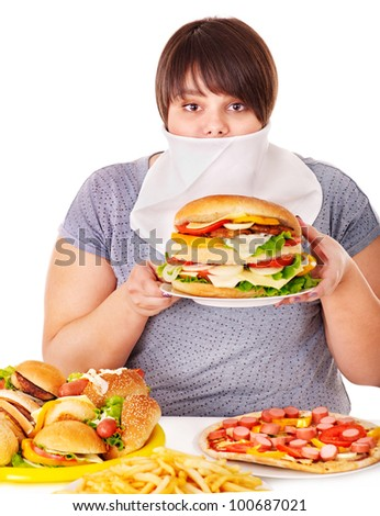 Overweight woman refusing fast food.