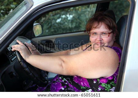 stock-photo-overweight-woman-sitting-behind-the-wheel-of-car-65051611.jpg