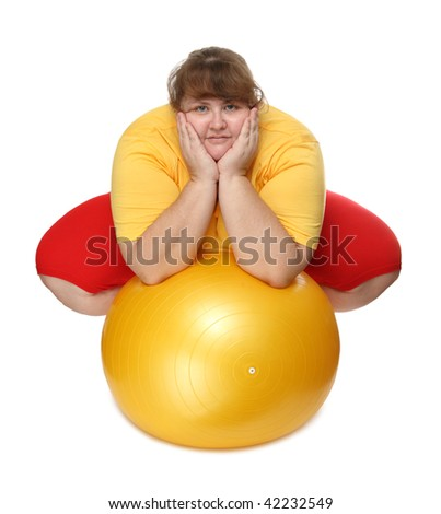 overweight woman sitting with gym ball on white