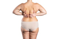 Overweight woman with fat back, hips and buttocks, obesity female body isolated on white background, excess weight and weight loss concept