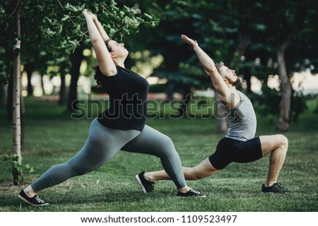 Overweight woman working out with personal trainer. Individual training outdoors. Fitness, sport, training, weight loss, teamwork and lifestyle concept.  ストックフォト ©