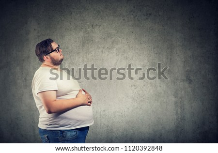 Overweight young man with big belly  Stock photo ©