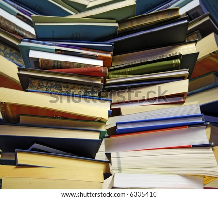 overwhelming piles of books