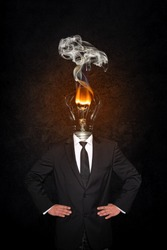 Overworked burnout business man standing headless with broken Bulb instead of his head. Symbolic Image - Stress Concept