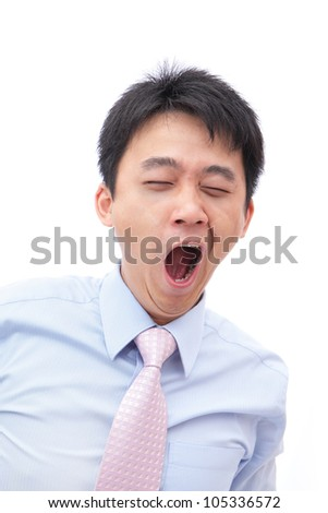 overworked business man yawn with black rim of eye isolated on white background, model is a asian people