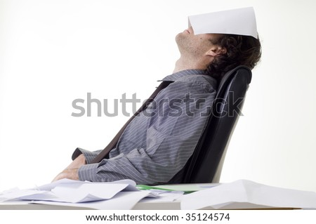 Overworked businessman with pile of paperwork