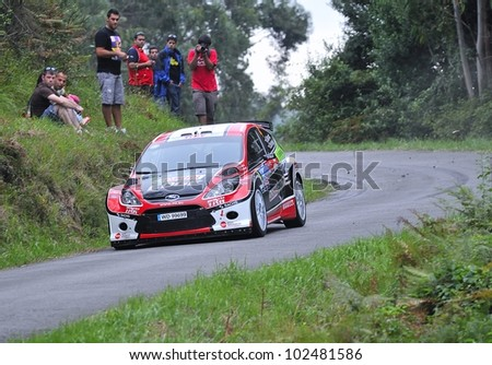 OVIEDO, SPAIN - SEPTEMBER 10: Maciej Oleksowicz drives a Ford S2000 car during Prince of Asturias rally championship on September 10, 2011 in Oviedo, Spain.