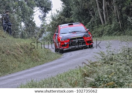 OVIEDO, SPAIN - SEPTEMBER 10: Ricardo Trivino drives a Mitsubishi Lancer X car during Prince of Asturias rally championship on September 10, 2011 in Oviedo, Spain.