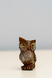 Owl Figure on white table symbol for money and wealth