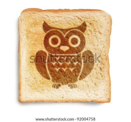 owl picture burnt mark on toast bread, isolated on white background