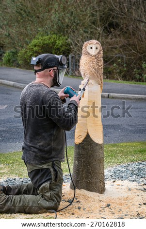 Owl Sculptor working / The making of an owl sculpture by a chainsaw sculptor here in the latter stages