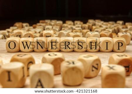 Ownership word written on wood block