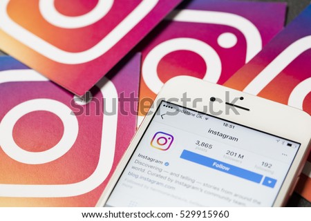 OXFORD, UK - DECEMBER 5th 2016: An apple iPhone showing the instagram application alongside other instagram printed logos. Instagram is a popular social media application for sharing images and videos
