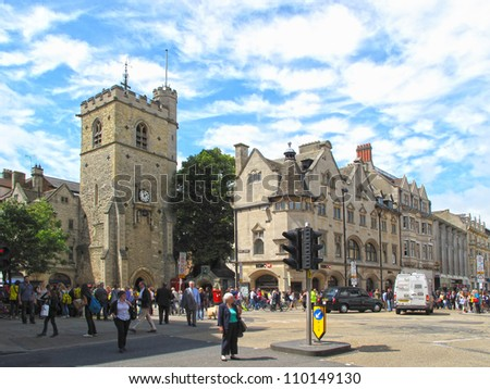 OXFORD, UK - JULY 17: Carfax Tower at the Cornmarket Street on July 17, 2012, Oxford, UK. Carfax Tower is considered to be the centre of the city, tower is from 13th century and it's busy place today.