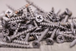 Oxidised screws, chrome-plated screws, brass-plated screws, a pile of assortment for domestic work.