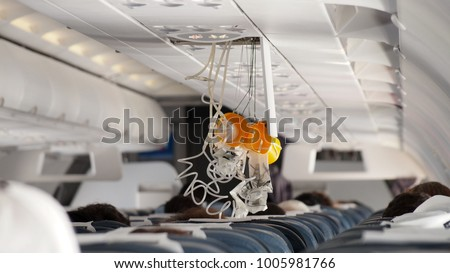 Oxygen Mask falling out in Airplane. #1005981766